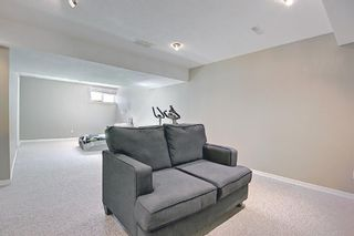 Photo 34: 403 950 Arbour Lake Road NW in Calgary: Arbour Lake Row/Townhouse for sale : MLS®# A1140525