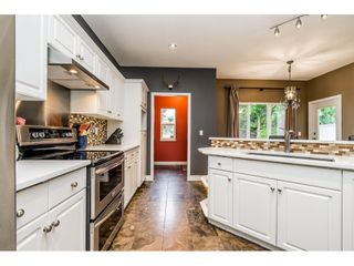 """Photo 29: 36309 S AUGUSTON Parkway in Abbotsford: Abbotsford East House for sale in """"Auguston"""" : MLS®# R2459143"""