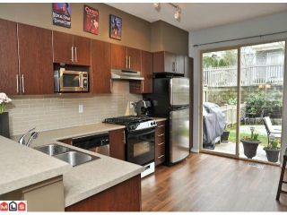 """Photo 4: 109 15152 62A Avenue in Surrey: Sullivan Station Townhouse for sale in """"UPLANDS"""" : MLS®# F1105019"""