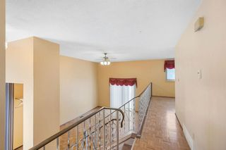 Photo 9: 128 Dovertree Place SE in Calgary: Dover Semi Detached for sale : MLS®# A1075565