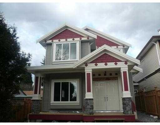 Main Photo: 615 EDGAR Avenue in Coquitlam: Coquitlam West 1/2 Duplex for sale : MLS®# V777992
