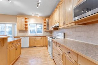 Photo 10: 7 39 Strathlea Common SW in Calgary: Strathcona Park Semi Detached for sale : MLS®# A1056254