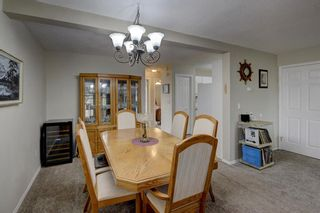 Photo 10: 103 219 Huntington Park Bay NW in Calgary: Huntington Hills Row/Townhouse for sale : MLS®# A1093664