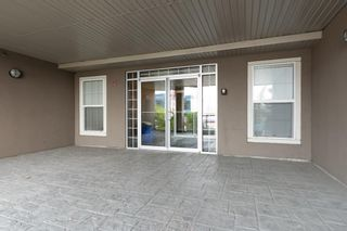 Photo 3: 102 15304 BANNISTER Road SE in Calgary: Midnapore Row/Townhouse for sale : MLS®# A1035618