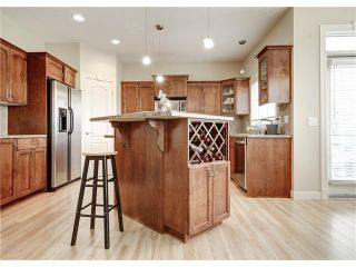 Photo 11: 118 PANATELLA CI NW in Calgary: Panorama Hills House for sale : MLS®# C4078386