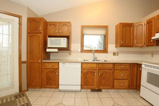 Photo 15: 2 WEST ANDISON Close: Cochrane House for sale : MLS®# C4141938