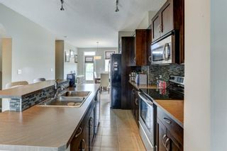 Photo 14: 1002 125 PANATELLA Way NW in Calgary: Panorama Hills Row/Townhouse for sale : MLS®# A1120145