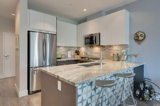 Photo 8: 113 Confluence Mews SE in Calgary: Downtown East Village Row/Townhouse for sale : MLS®# A1138938
