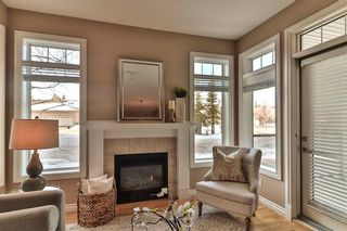 Photo 1: 111 2121 98 Avenue SW in Calgary: Palliser Apartment for sale : MLS®# A1076352