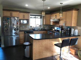 Photo 2: 8348 87 Avenue in Fort St. John: Fort St. John - City SE 1/2 Duplex for sale (Fort St. John (Zone 60))  : MLS®# R2581736