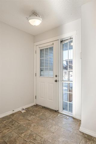Photo 2: 49 Royal Birch Mount NW in Calgary: Royal Oak Row/Townhouse for sale : MLS®# A1058936