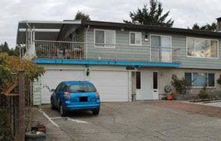Photo 2: 703 QUADLING Avenue in Coquitlam: Coquitlam West House for sale : MLS®# R2610291