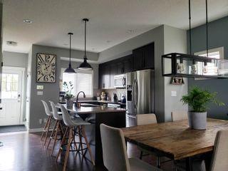 Photo 11: 179 HAWKS RIDGE Boulevard in Edmonton: Zone 59 House Half Duplex for sale : MLS®# E4261420