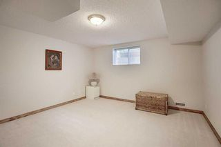 Photo 29: 13 Strathearn Gardens SW in Calgary: Strathcona Park Semi Detached for sale : MLS®# A1114770