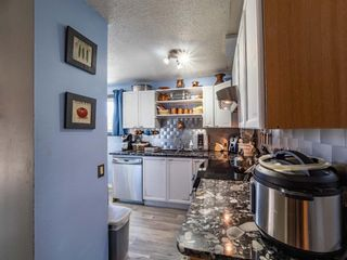Photo 6: 3910 29A Avenue SE in Calgary: Dover Row/Townhouse for sale : MLS®# A1077291