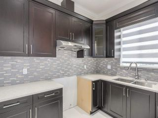 """Photo 9: 18415 59A Avenue in Surrey: Cloverdale BC House for sale in """"CLOVERDALE"""" (Cloverdale)  : MLS®# R2251135"""