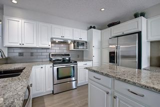 Photo 7: 11 Strathcanna Court SW in Calgary: Strathcona Park Detached for sale : MLS®# A1079012