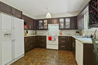 """Photo 10: 1306 FLYNN Crescent in Coquitlam: River Springs House for sale in """"River Springs"""" : MLS®# R2588177"""