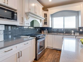 """Photo 6: 21153 77B Avenue in Langley: Willoughby Heights Condo for sale in """"Yorkson Shaunessy Mews"""" : MLS®# R2338148"""