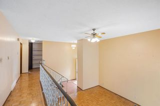 Photo 10: 128 Dovertree Place SE in Calgary: Dover Semi Detached for sale : MLS®# A1075565