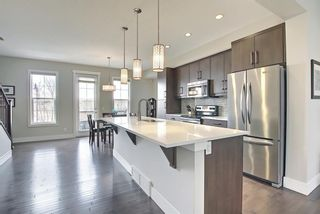Photo 14: 444 Quarry Way SE in Calgary: Douglasdale/Glen Row/Townhouse for sale : MLS®# A1094767