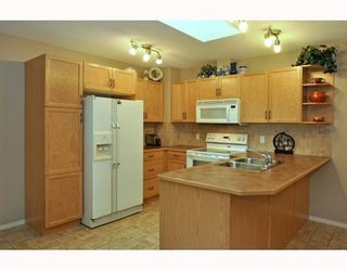Photo 5: 579 STONEGATE Way NW: Airdrie Residential Attached for sale : MLS®# C3397152