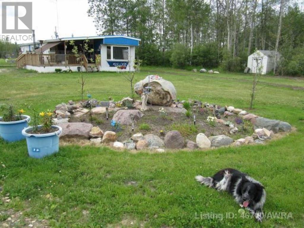 Main Photo: 217 FORESTRY  Road in Red Earth Creek: House for sale : MLS®# A1034808