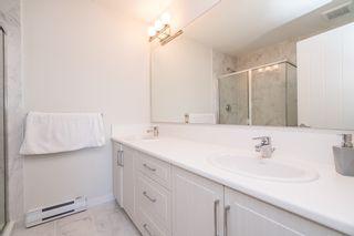 """Photo 20: 100 14555 68 Avenue in Surrey: East Newton Townhouse for sale in """"SYNC"""" : MLS®# R2169561"""