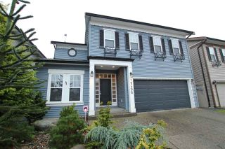 Photo 1: 19496 HOFFMANN Way in Pitt Meadows: South Meadows House for sale : MLS®# R2024633