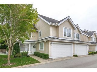 """Photo 1: 16 17097 64 Avenue in Surrey: Cloverdale BC Townhouse for sale in """"Kentucky Lane"""" (Cloverdale)  : MLS®# R2625431"""