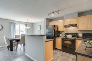 Photo 7: 56 Elgin Gardens SE in Calgary: McKenzie Towne Row/Townhouse for sale : MLS®# A1009834
