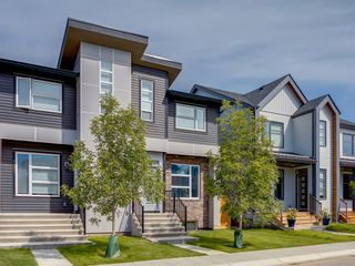 Photo 1: 105 Seton Terrace SE in Calgary: Seton Semi Detached for sale : MLS®# A1009994