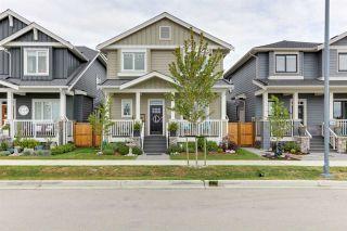 "Photo 1: 2290 CORMORANT Drive in Tsawwassen: Tsawwassen North House for sale in ""NEW HAVEN"" : MLS®# R2621277"