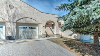 Main Photo: 95 Sandarac Circle NW in Calgary: Sandstone Valley Row/Townhouse for sale : MLS®# A1099915