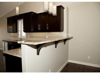 Photo 6: 130 RIVERSIDE Crescent NW: High River Residential Attached for sale : MLS®# C3612435