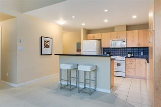 Photo 5: 101 1088 6 Avenue SW in Calgary: Downtown West End Apartment for sale : MLS®# A1031255