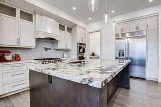 Photo 8: 907 31 Avenue NW in Calgary: Cambrian Heights Detached for sale : MLS®# A1095749