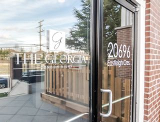 """Photo 4: 406 20696 EASTLEIGH Crescent in Langley: Langley City Condo for sale in """"The Georgia"""" : MLS®# R2621098"""