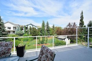 Photo 48: 104 GLENEAGLES Landing: Cochrane House for sale : MLS®# C4127159