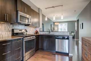 Photo 6: 440 Ascot Circle SW in Calgary: Aspen Woods Row/Townhouse for sale : MLS®# A1090678