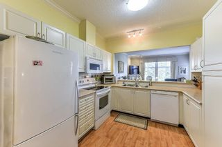 "Photo 7: 404 15323 17A Avenue in Surrey: King George Corridor Condo for sale in ""SEMIAHMOO PLACE"" (South Surrey White Rock)  : MLS®# R2308322"