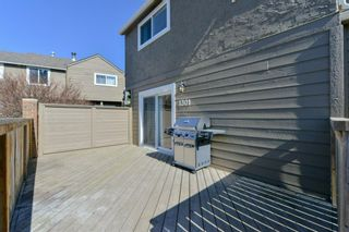 Photo 5: 1301 829 Coach Bluff Crescent in Calgary: Coach Hill Row/Townhouse for sale : MLS®# A1094909