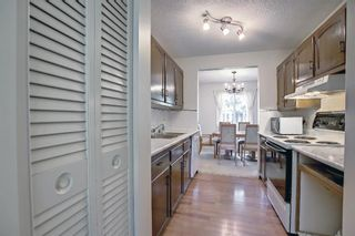Photo 8: 104 210 86 Avenue SE in Calgary: Acadia Row/Townhouse for sale : MLS®# A1148130