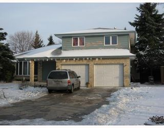 Photo 1: 15 ENVOY Crescent in WINNIPEG: West Kildonan / Garden City Single Family Detached for sale (North West Winnipeg)  : MLS®# 2902158