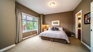 Photo 25: 38 Somme Boulevard SW in Calgary: Garrison Woods Row/Townhouse for sale : MLS®# A1112371