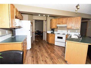 Photo 9: 22 Cimarron Meadows Way: Okotoks House for sale : MLS®# C4104563