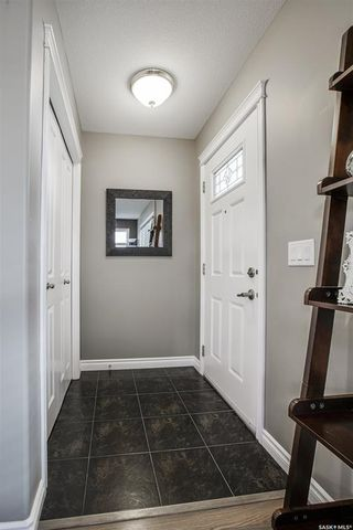Photo 4: 402 Maningas Bend in Saskatoon: Evergreen Residential for sale : MLS®# SK860413