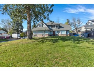 """Photo 1: 18063 60 Avenue in Surrey: Cloverdale BC House for sale in """"Cloverdale"""" (Cloverdale)  : MLS®# R2575955"""
