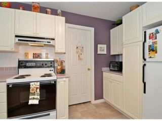 """Photo 9: 217 7161 121ST Street in Surrey: West Newton Condo for sale in """"The Highlands"""" : MLS®# F1418736"""