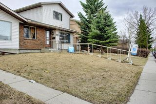 Photo 2: 329 Woodvale Crescent SW in Calgary: Woodlands Semi Detached for sale : MLS®# A1093334